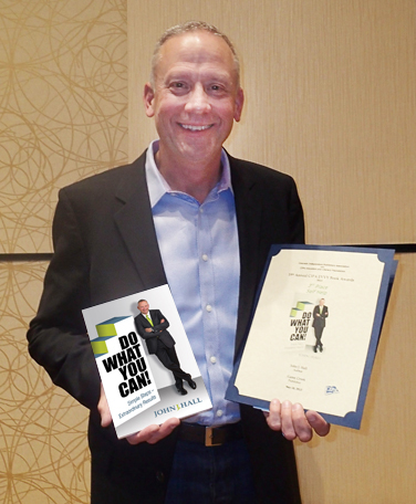 John Hall with his book awards